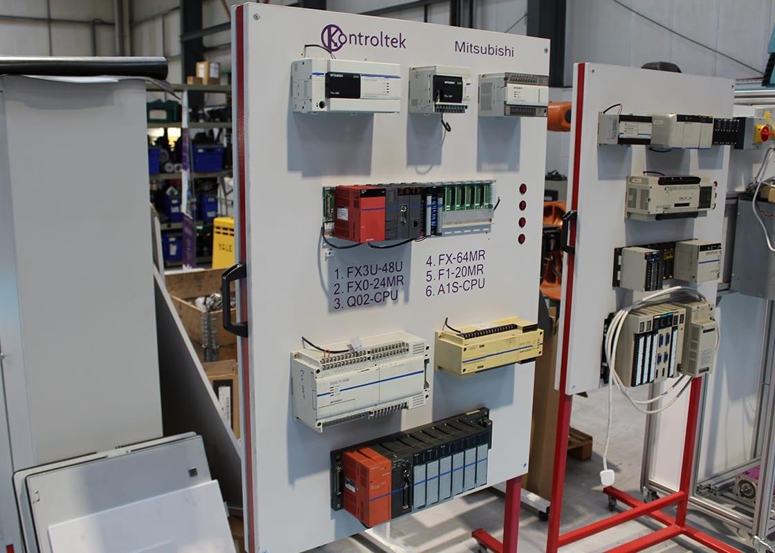 Kontroltek test rig of Mitsubishi Electric FX3U-48U FX0-24MR Q02-CPU FX-64MR F1-20MR A1S-CPU.