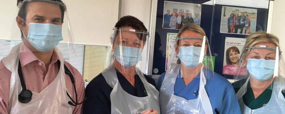 NHS staff wearing PPE, face shields, made by Kontroltek engineers.
