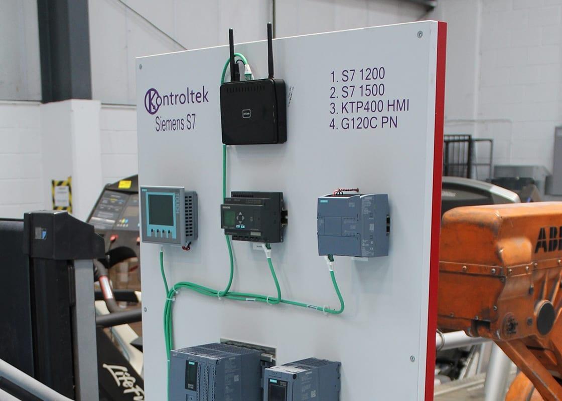 Kontroltek Siemens S7 test rig in the Kontroltek workshop. S7 100 S7 1500 KTP400 HMI G120C PN
